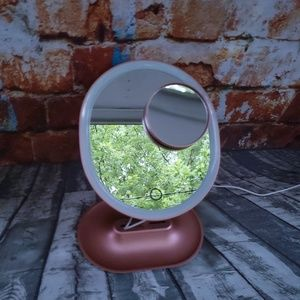 Rose gold LED magnifying mirror